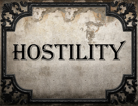 hostility: hostility word on concrette wall