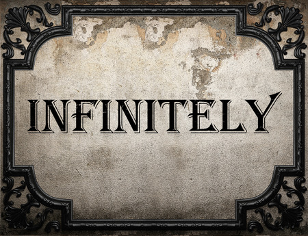 infinitely: infinitely word on concrette wall Stock Photo