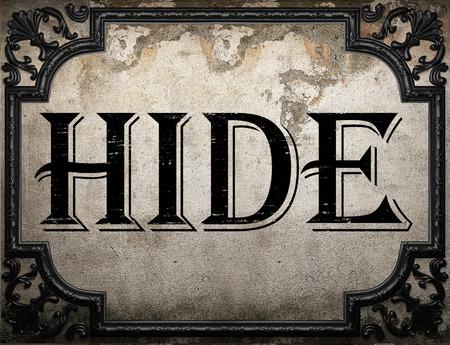hide word on concrette wall