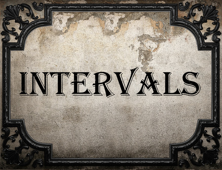 intervals: intervals word on concrette wall Stock Photo