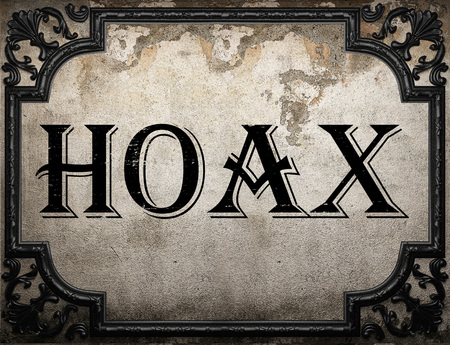 hoax: hoax word on concrette wall