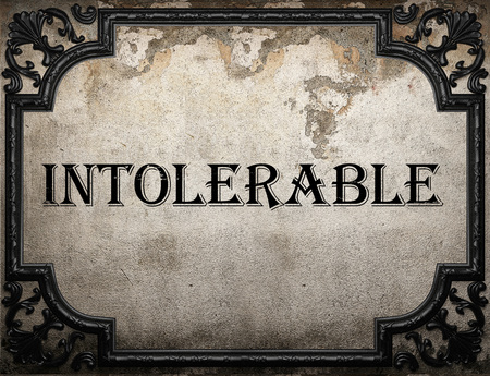 intolerable: intolerable word on concrette wall Stock Photo