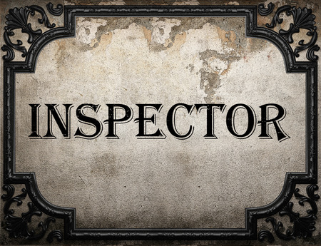 inspector: inspector word on concrette wall Stock Photo
