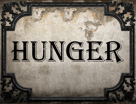 hunger word on concrette wall