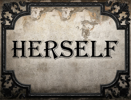 herself: herself word on concrette wall Stock Photo