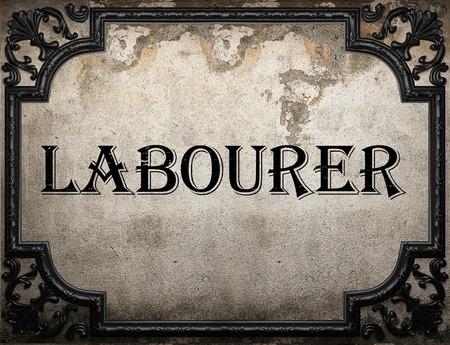 obrero: palabra obrero en la pared concrette Foto de archivo