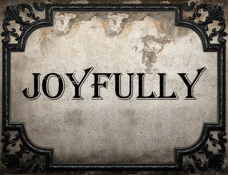 joyfully: joyfully word on concrette wall
