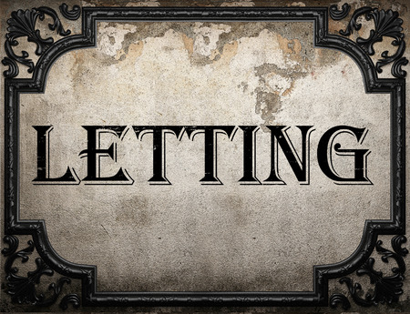 letting: letting word on concrette wall Stock Photo