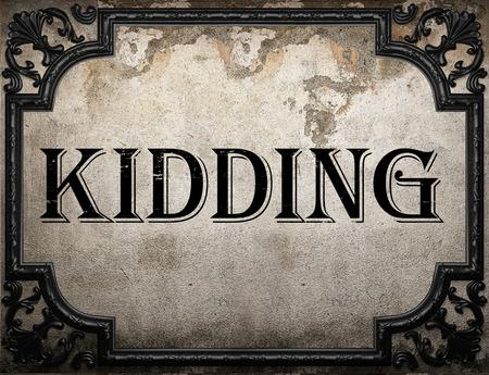 kidding: kidding word on concrette wall