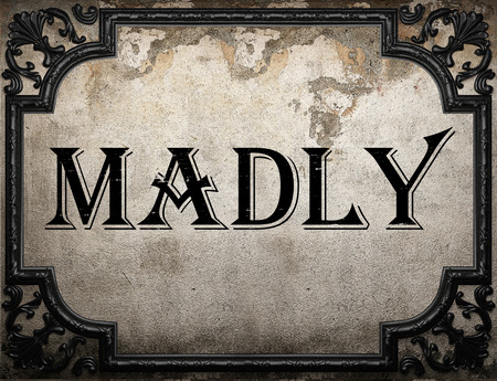 madly: madly word on concrette wall