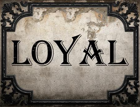 loyal: loyal word on concrette wall