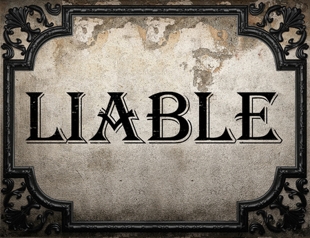liable: liable word on concrette wall Stock Photo