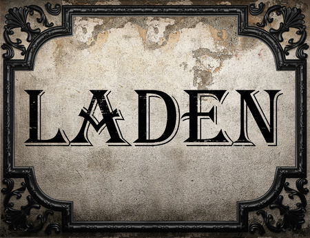 laden: laden word on concrette wall