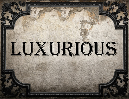 luxurious: luxurious word on concrette wall Stock Photo
