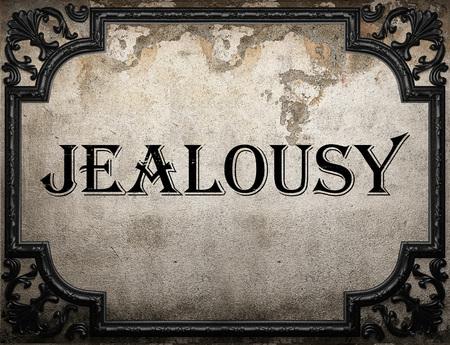 celos: palabra celos en la pared concrette