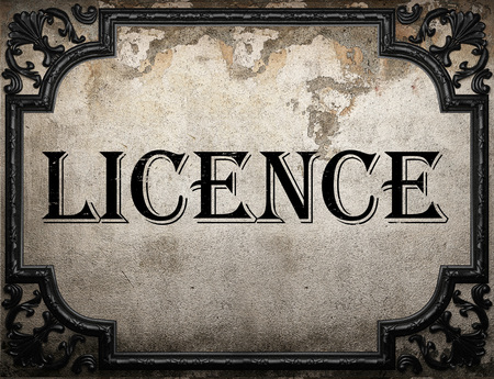 licence: licence word on concrette wall