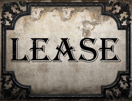 lease: lease word on concrette wall Stock Photo