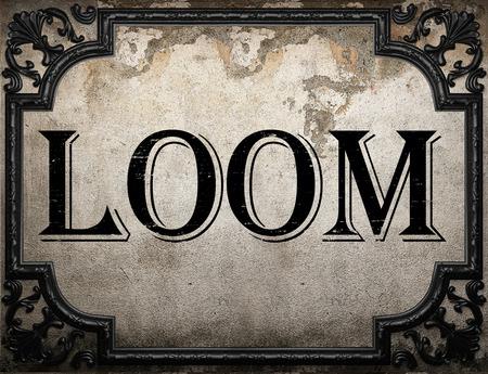 loom: loom word on concrette wall