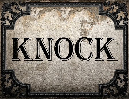 knock: knock word on concrette wall
