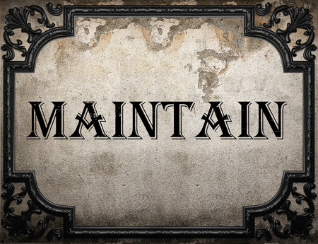 maintain: maintain word on concrette wall