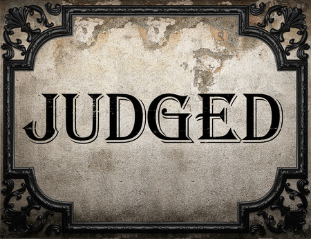 judged: judged word on concrette wall