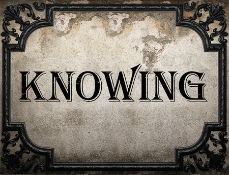 knowing: knowing word on concrette wall