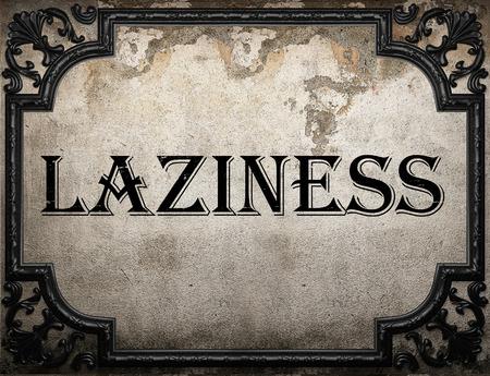 laziness: laziness word on concrette wall