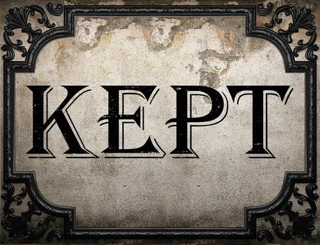 kept: kept word on concrette wall