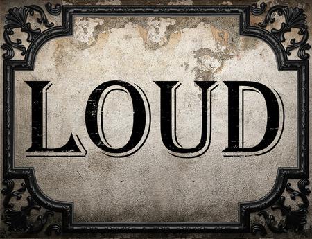 loud: loud word on concrette wall