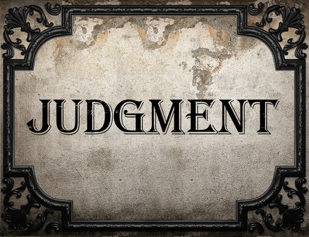judgment: judgment word on concrette wall Stock Photo