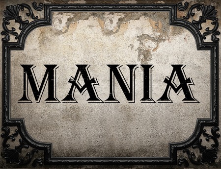mania: mania word on concrette wall