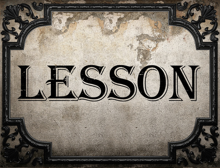 word lesson: lesson word on concrette wall