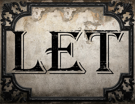 let: let word on concrette wall