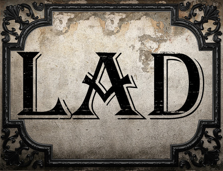 lad: lad word on concrette wall