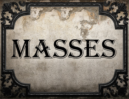 masses: masses word on concrette wall