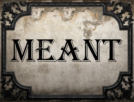 meant: meant word on concrette wall Stock Photo