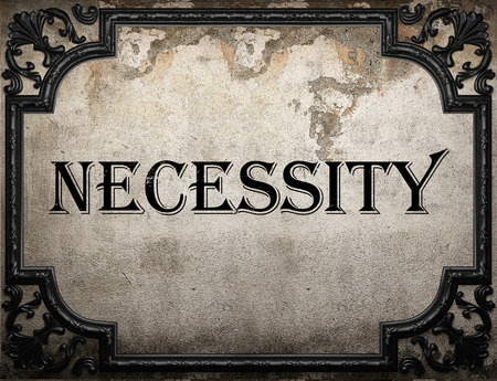 necessity: necessity word on concrette wall