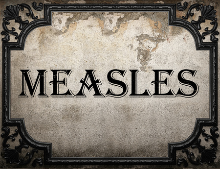 measles: measles word on concrette wall