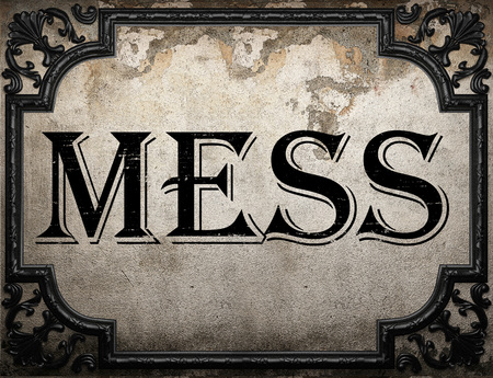 mess: mess word on concrette wall