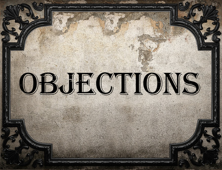 objections: objections word on concrette wall Stock Photo