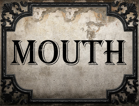 word of mouth: mouth word on concrette wall