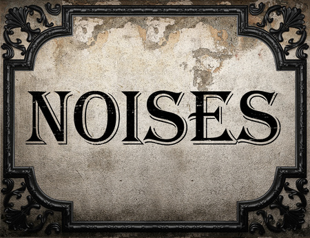 noises: noises word on concrette wall