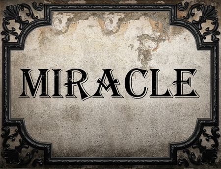 miracle: miracle word on concrette wall