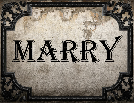 marry: marry word on concrette wall