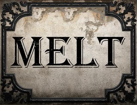 melt: melt word on concrette wall Stock Photo