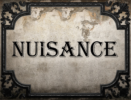 nuisance: nuisance word on concrette wall