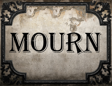 mourn: mourn word on concrette wall