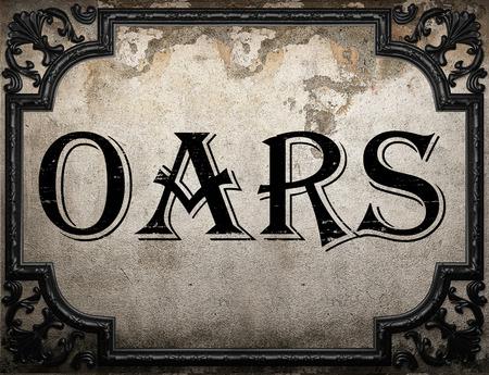 oars: oars word on concrette wall Stock Photo