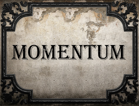 momentum: momentum word on concrette wall