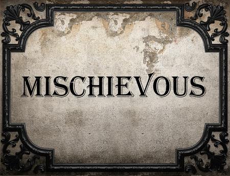 mischievous: mischievous word on concrette wall